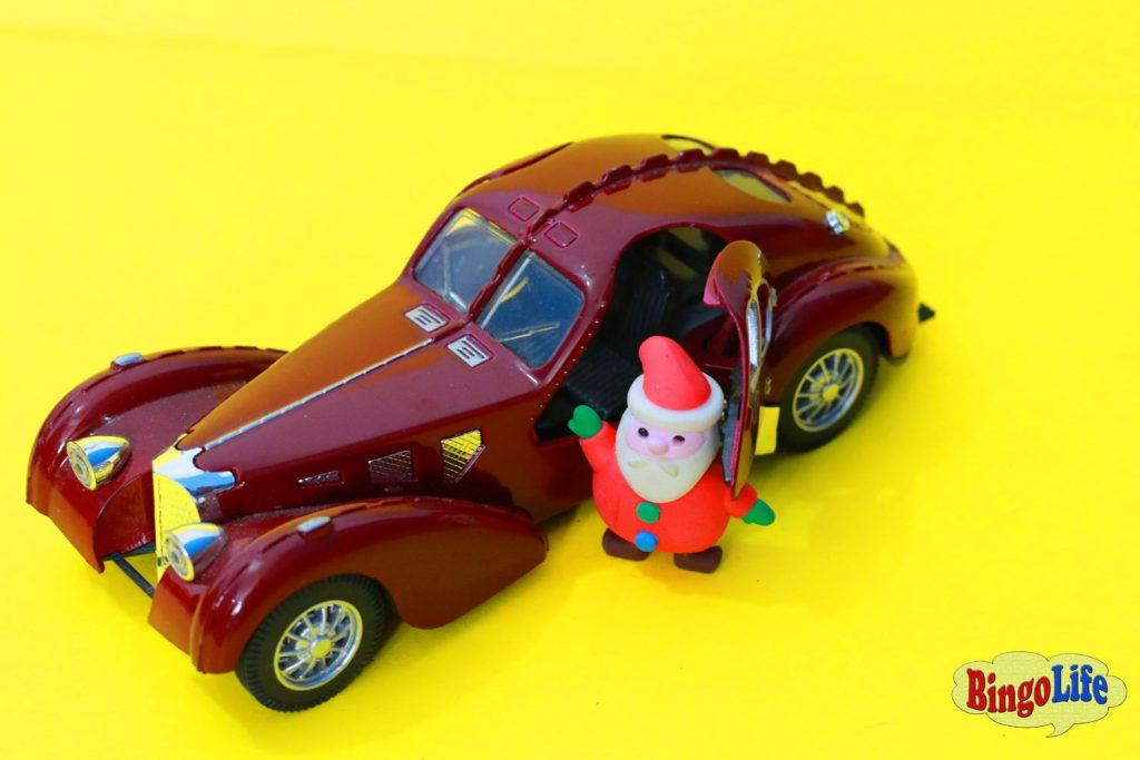 Santa Claus with brown car