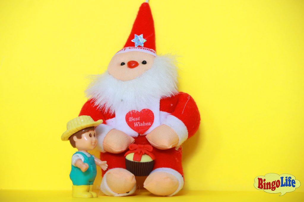 Santa giving gift to kid