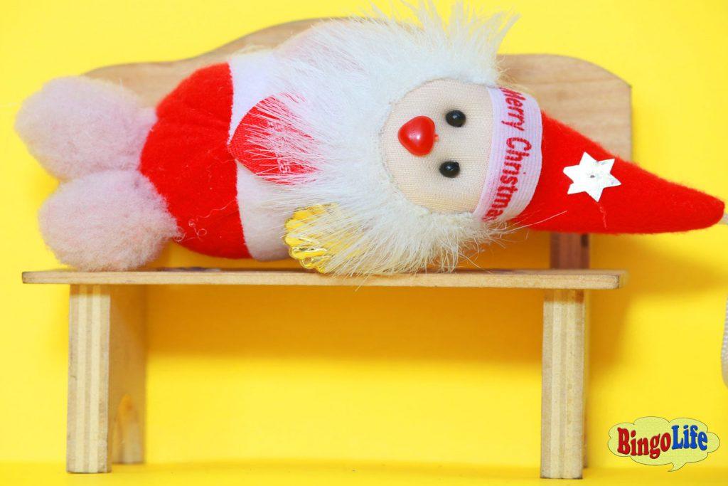 Santa lying on chair
